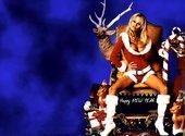 Pamela Anderson assise  Fonds d'écran